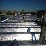 Tratamento em Telhados com Manta Aluminizada
